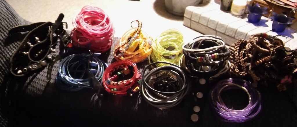 Bracelets, mostly jelly and plastic bangles.