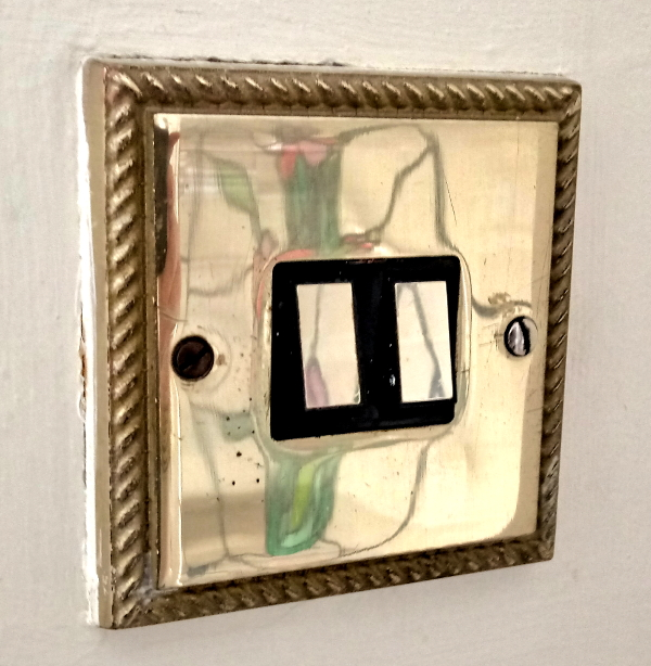 '80s brass light switches